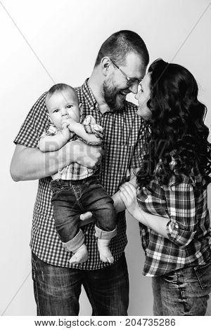 black and white portrait of young family with a baby boy