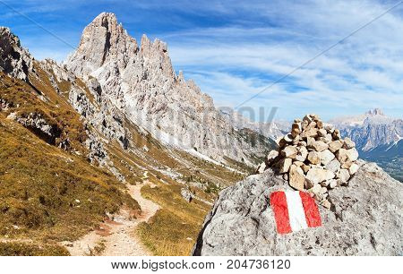 Cima Ambrizzola and Croda da Lago with pathway and tourist sign Alps Dolomites Mountains Italy