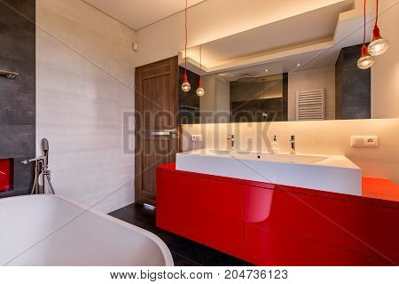 Bathroom With Red Cabinet