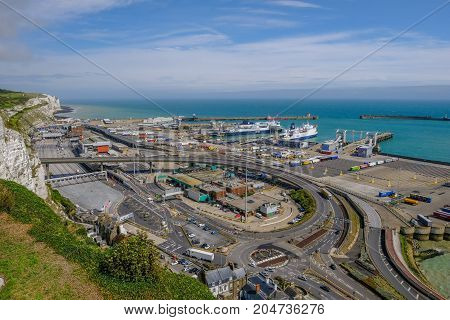 Dover Kent England Uk - August 17.2017: Ariel view of the Dover Ferry Port and harbour taken from the viewing point at the Castle. Daytime shot made with a wide angle lens.