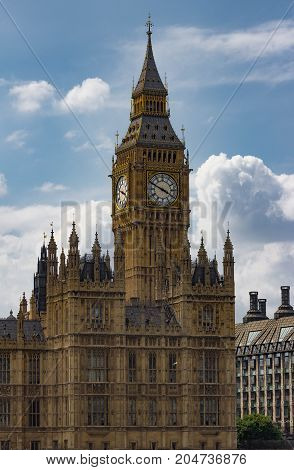 Vertical isolated view of the famous Big Ben Clock Tower in London, England against perfect fluffy clouds.