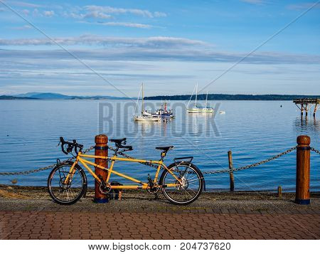 Seawalk in Sidney Vancouver Island British Columbia; bike leans on the rail post