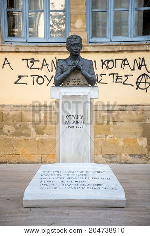 Nicosia, Cyprus, March 2017: Bust of Ourania Kokkinou in front of Faneromeni High School in Nicosia city centre Cyprus