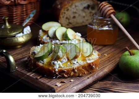 toast with cottage cheese ,pear and honey on a wooden tray