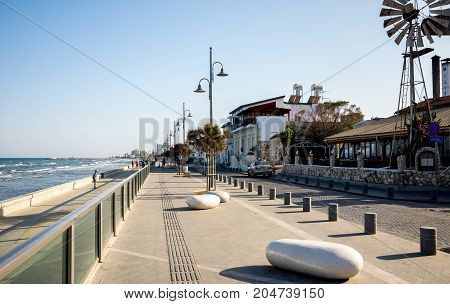 Larnaca, Cyprus, March 2017: Larnaca embankment with sea-front cafes and restaurants Cyprus