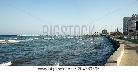 Larnaca, Cyprus, March 2017: A view to Larnaca embankment and MacKenzie Marina in background Cyprus