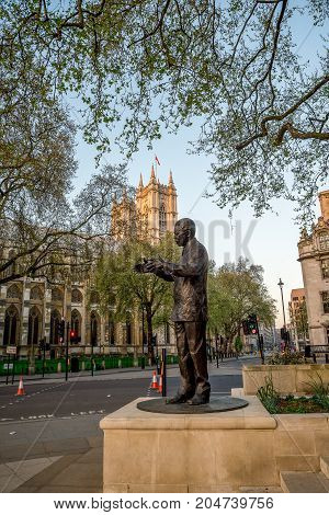 London, England, April 2017: Statue of Nelson Mandela in Parliament Square Garden in Westminster Central London