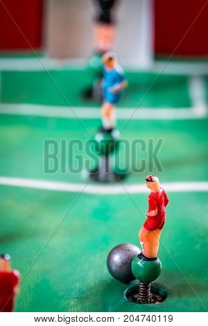 Close-up shot players figures of a tabletop football game