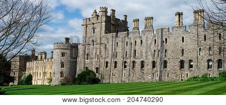 London, England, April 2017: View of Windsor Castle walls and tower with arched windows county of Berkshire England