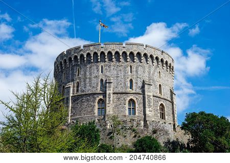 Windsor, England, April 2017: Round Tower with a raised flag in Windsor Castle county of Berkshire England