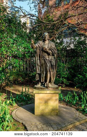 London, England, April 2017: A statue of John Wesley in St Paul's Cathedral churchyard London Great Britain