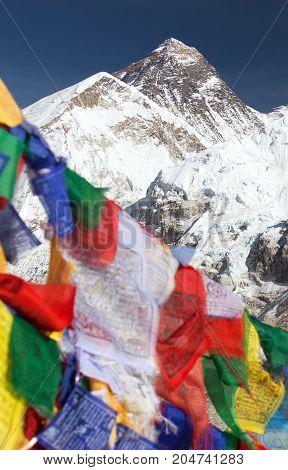view of Mount Everest with buddhist prayer flags from Kala Patthar way to Everest base camp Sagarmatha national park Khumbu valley Solukhumbu Nepal Himalayas
