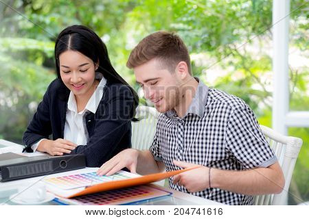 young business people making meeting and looking at document for analyzing marketing working at office on desk.