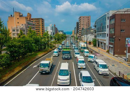 KYOTO, JAPAN - JULY 05, 2017: Aerial view of cars on the street of Kyoto in Japan. Kyoto Metropolis is one of the most populous city of Japan.