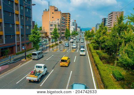 KYOTO, JAPAN - JULY 05, 2017: Cars on the street of Kyoto in Japan. Kyoto Metropolis is one of the most populous city of Japan.