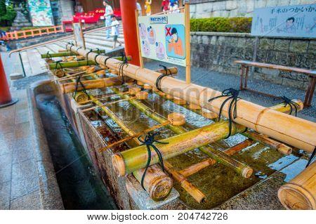 KYOTO, JAPAN - JULY 05, 2017: Close up of hand wash pavilion in Fushimi Inari Shrine in Kyoto, Japan
