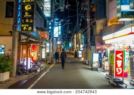 KYOTO, JAPAN - JULY 05, 2017: Night scene of tourists wondering around the narrow street of Gion DIstrict, Kyoto, Japan.