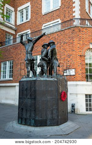 London, England, April 2017: The Firefighters memorial in Carter Lane Gardens next to St Paul's Cathedral in central London England