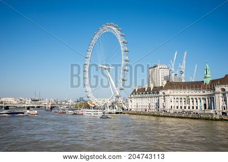 London, England, April 2017: A view to London Eye from Westeminster bridge England