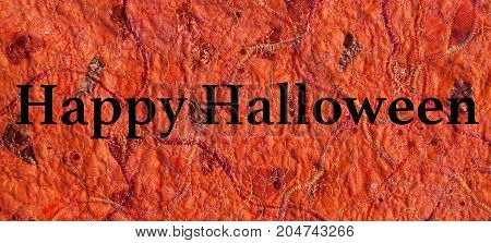 Various shades of orange fabrics with different textures and zigzag stitched patterns with variegated threads created using a sewing machine. With Halloween text.