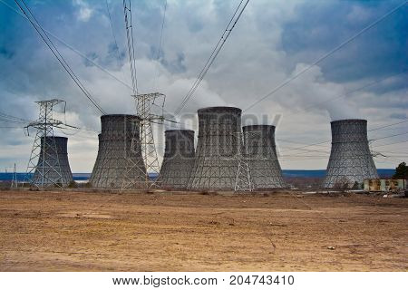 Cooling tower of Nuclear Power plant and power lines in the wastelands