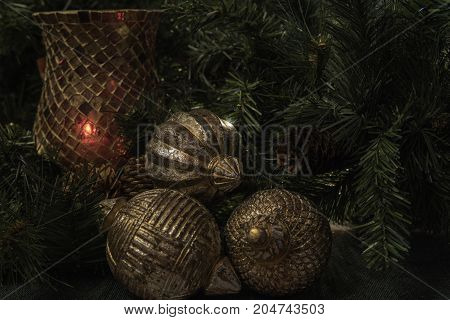 Horizontal Christmas display background with red candle holder and antique wooden gold ball ornaments