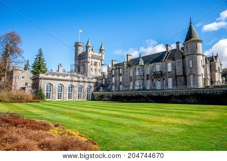 Balmoral, Scotland, April 2017: Back side of Balmoral Castle and a lawn behind Aberdeenshire Scotland