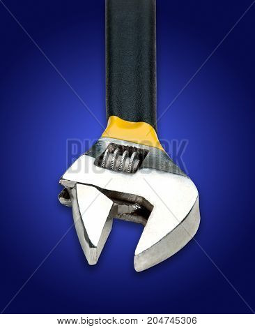 Adjustable Wrench On Blue Background