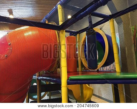 Detail of colorful plastic playground to entertain the little ones at home