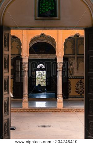 JAIPUR RAJASTHAN INDIA - MARCH 11 2016: Vertical picture of open door with a nice view of dark room at Nahargarh Fort located in Jaipur the pink city of India