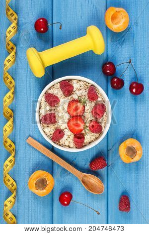 Oat Flakes With Fruits, Dumbbells And Centimeter, Slimming And Healthy Lifestyle Concept