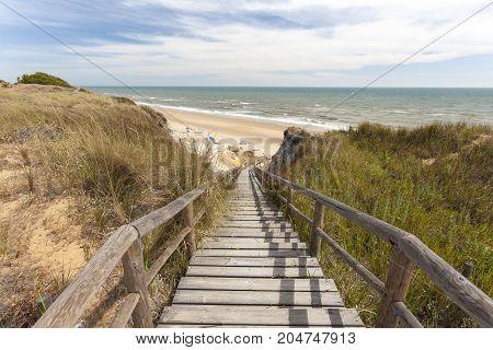 Stairway to the Playa del Asperillo beach in Matalascanas. Donana Natural Park Huelva province Costa de la Luz Andalusia Spain