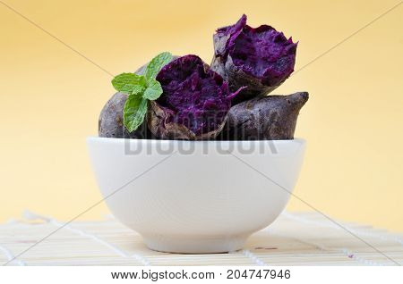 Purple sweet potatoes in a bowl for eating