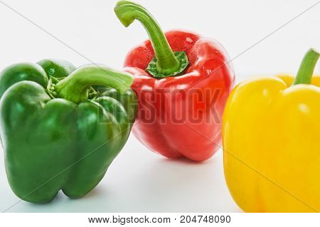 Bell pepper is a group of many colors on a white background.