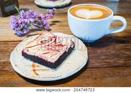 Sliced brownie and latte coffee in the morning