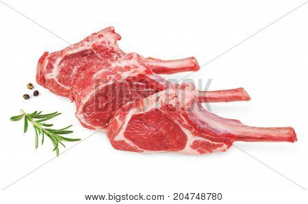 Fresh lamb cutlet with rosemary and pepper isolated on white background.