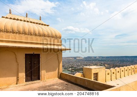 JAIPUR RAJASTHAN INDIA - MARCH 11 2016: Horizontal picture of yellow painted room inside Nahargath Fort on the top of the mountains of Jaipur known as pink city in India.