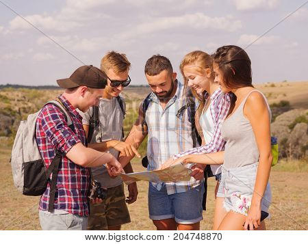 Couple or friends navigating together keep smiling happy during camping travel hike outdoors.