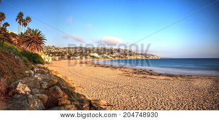 Golden Hour over the ocean through a neutral density filter at Main Beach in Laguna Beach California USA