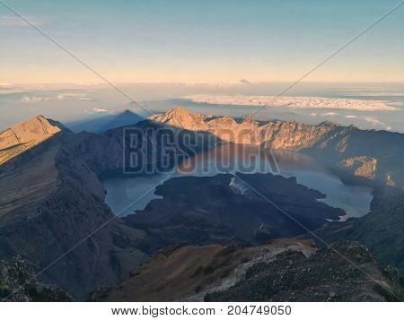 View from mountain Rinjani Summit at sunrise time. Mountain Rinjani at Lombok, Indonesia.