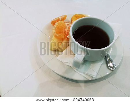 A cup of coffee and fresh fruit. Picture with copy space