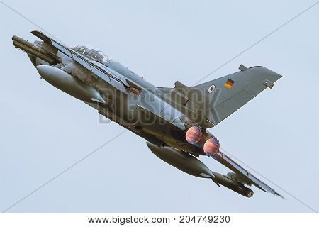 Schleswig - Jagel Germany - June 19 2014: Germany - Air Force Panavia Tornado board number 4632 is takeoff for background of blue sky during NATO Tiger Meet 2014