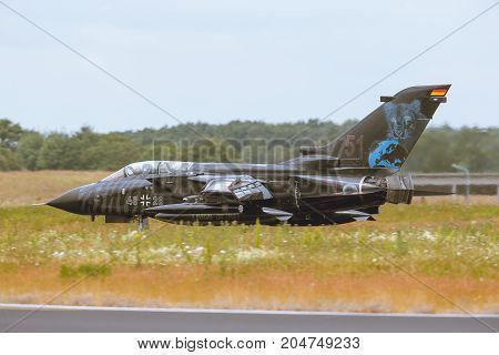 Schleswig - Jagel Germany - June 19 2014: Germany - Air Force Panavia Tornado board number 4628 taxiing on runway after landing during NATO Tiger Meet 2014