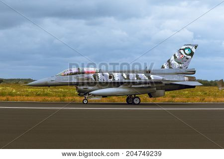 Schleswig - Jagel Germany - June 19 2014:Wojska Lotnicze Sily Powietrzne General Dynamics F-16 Fighting Falcon board number 4084 is taxiing during Tiger Meet 2014. The plane has a special painter