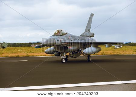 Schleswig - Jagel Germany - June 19 2014: Netherlands - Air Force General Dynamics F-16A Fighting Falcon J-643 is taxiing on strip of airbase Schleswig - Jagel during NATO Tiger Meet 2014.