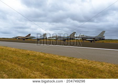 Schleswig - Jagel Germany - June 19 2014: Two Netherlands - Air Force F-16 Fighting Falcon and two French Air Force Dassault Mirage 2000 is taxiing during Tiger Meet 2014.