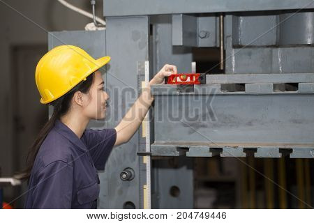 young asian woman engineer set up and testing machine in the laboratory factory engineering and industrial concept