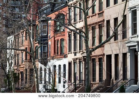 Block of historic brownstone buildings in Manhattan New York City NYC