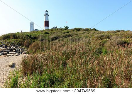 Lighthouse on the sand dune bluff overlooking the beach at Montauk Point, Long Island, New York