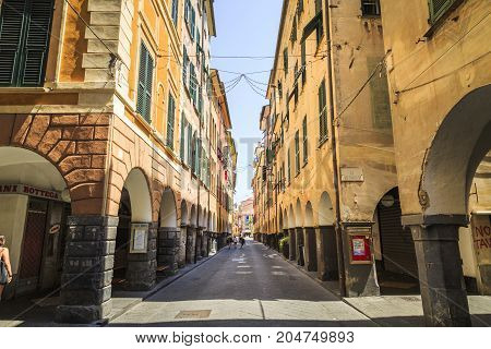 PRATI ITALY - JUNE 26 2016: A wide picture of an alley with colorful houses and closed stores in a sunny day with clean blue sky. Prati Italy.